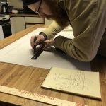 Evan Henderson drafting makerspace floor plans