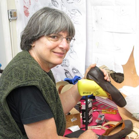 Jeanne Flanagan making shoes